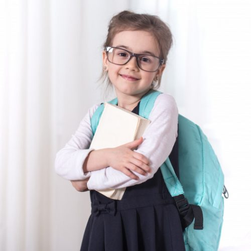 girl-elementary-school-student-with-backpack-book_169016-1839