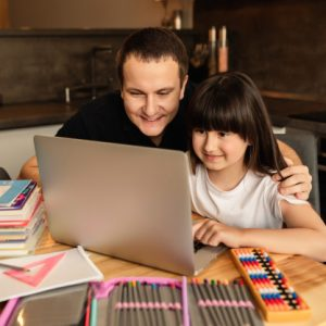 online-learning-family-togetherness-while-doing-homework-father-helps-daughter-online-lesson-home_222709-754