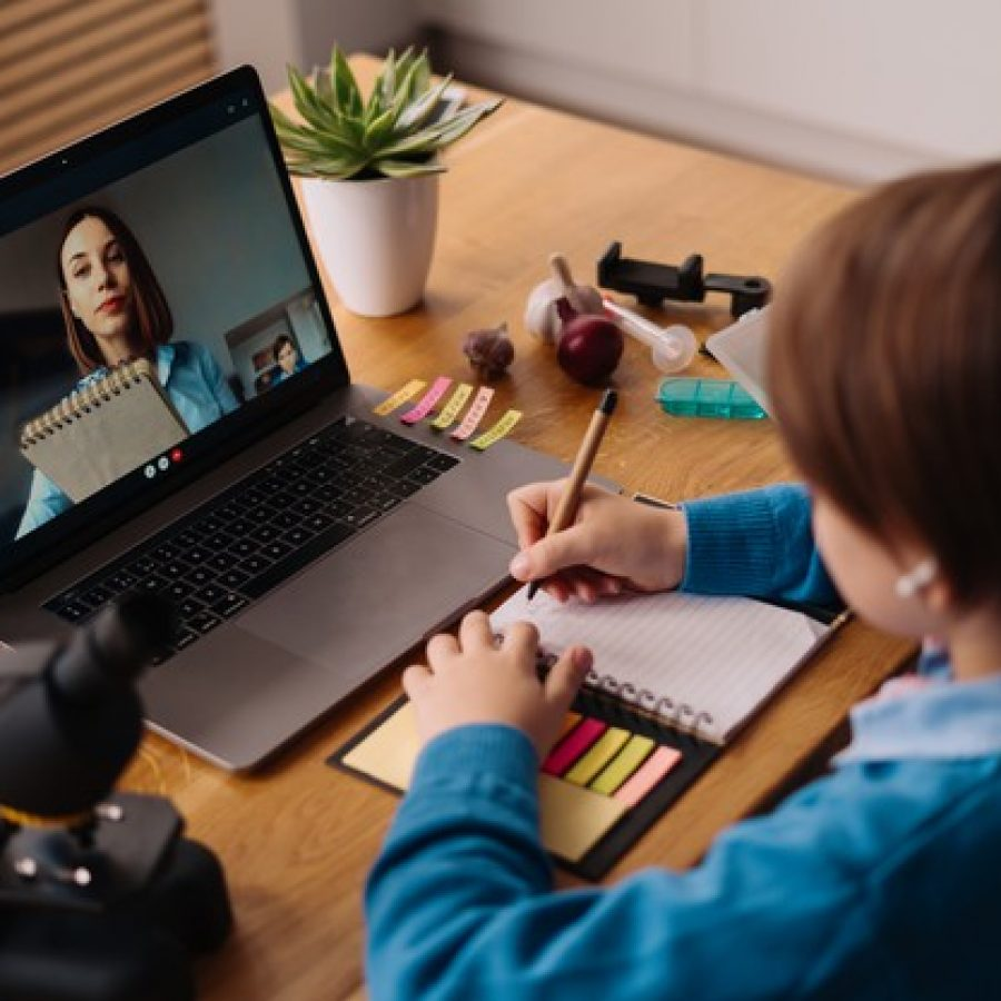 preteen-boy-uses-laptop-make-video-call-with-his-teacher_158595-7520